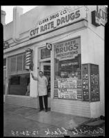 Orville Clark stands before his drug store, Los Angeles, 1938