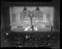 Coronation of Tournament of Roses queen Barbara Dougall by Lathrop K. Leishman at the Civic Auditorium, Pasadena, 1938