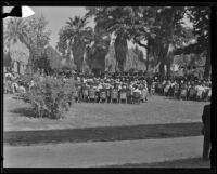 A crowd watches Governor Frank Merriam give a speech, Whittier, 1934