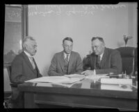 Martin G. Aguirre and Frank Dewar seated at a desk, Los Angeles, 1920-1929