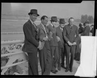 Fred Alger Jr., Alfred Gwynne Vanderbilt, and Hugh Blue at the Santa Anita race track, Arcadia, 1930s