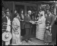 Crombie Allen hands key for newly dedicated Mexican Olympic cottage to Mrs. Christine Sterling, Olvera Street, Los Angeles, 1933