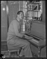 Peter Arno, cartoonist, playing a piano, 1927-1939