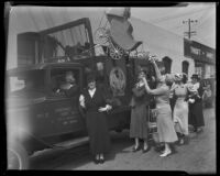 Mrs. Sherman Danby and Mrs. Lou Anger pose with new Assistance League truck, Los Angeles, 1933