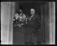 John C. Austin and Wife standing in front of a stone doorway