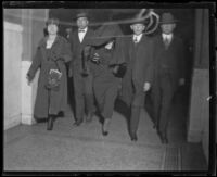 Accused killer Louise Peete is escorted to court to be arraigned for the murder of Jacob Denton, Los Angeles, 1920