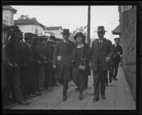 Accused killer Louise Peete is escorted to court by her husband Richard Peete (on her left) and bailiff Martin Aguirre, Los Angeles, 1921