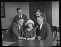 Peggy Caffee, witness to the murder of Alberta Meadows, with District Attorney William C. Doran and detective Dwight Longuevan, Los Angeles, 1922