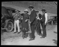 Peggy Caffee, witness of the murder of Alberta Meadows, points to the location of the crime to police detective Sergeant Dwight Longuevan, Los Angeles, 1922