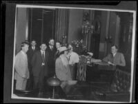 Clara Phillips and others before a judge in a courtroom during the time of her trial for the murder of Alberta Meadows, Los Angeles, 1922-1923