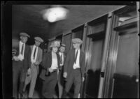 Woman and 3 men photographed in a hallway in relation to the murder of Alberta Meadows by Clara Phillips, 1922-1923