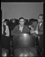Actress ZaSu Pitts seated in an auditorium or courtroom, Los Angeles, 1930-1939