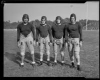 Four players from the Pomona Football team on the first day of practice, Pomona, 1933