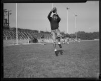 Pomona College football player during the first practice of the season, Pomona, 1933