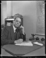Arturo Rios, Chilean Consul-General in Los Angeles, seated at his desk, Los Angeles, 1934