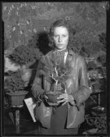Jean Robinson holds a dwarf tree, Pasadena, 1933