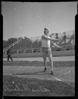 Alma Richards engaged in a discus throw, circa 1912-1920