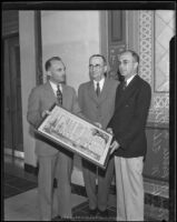 Paul Ritter and Hugh J. McGuire with Arthur Eldridge as he receives a laudation for his work, Los Angeles, 1934