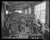 Workers creating chairs and tables in the Roberti Brothers' furniture factory, Los Angeles, circa 1920-1930