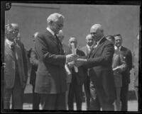 French Consul Louis Sentous presents Henry M. Robinson with Legion of Honor medal, Los Angeles, 1925