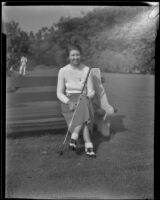 Lucille Robinson seated on a bench at the Los Angeles Country Club, Los Angeles, 1934