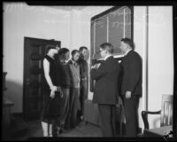 Lillian Butterfield with 3 young men, Coroner Ira Nance and Judge Louis Russill, Los Angeles, 1931
