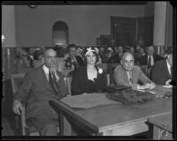 Photograph of Myrtle St. Pierre seated with Lorrin Andrews and another attorney at the County Courthouse, Los Angeles, 1932