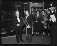 Joseph F. Sartori, banker and civic leader, with his wife Margaret, on a sidewalk in evening attire, Los Angeles, 1928