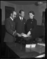 Norris G. Stensland, Eric Pedley, and Bess Bailey investigate extortion letter, Los Angeles, 1933