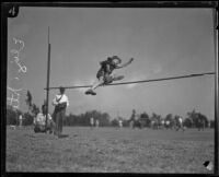 Elizabeth Stine, track athlete, engaged in high jump, circa 1922-1926