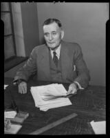 Bill Lane, owner of the Hollywood Stars baseball team, seated at a desk, Los Angeles, 1935
