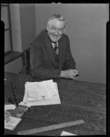 Spider Baum seated at a desk, Los Angeles, 1935