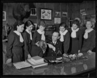 Fire Chief Scott presenting a fire prevention award to students of the Sacred Heart High School, Los Angeles, 1935