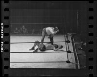 Referee administering a count during a Hank Hankinson boxing match, 1935