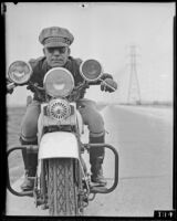 Forrest Underwood, Highway Patrol officer, on a motor cycle, 1935