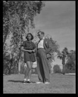Jinx Falkenburg and Gregory Ratoff stand together, Palm Springs, 1935