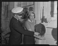 Officer C. C. Kinnett instructs Leah Howe about the engine order telegraph, 1935