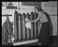 Leah Howe stands next to missiles during a Navy militia event, 1935
