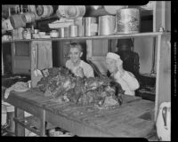 Bob Boyd & Chef George Arnold cutting beef for Thanksgiving for the Rescue Mission, Los Angeles, 1936