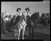 Two women on horseback at a horse show, Anaheim, 1935