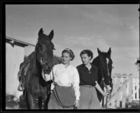 Marjory Kilner and Charlotte La Bonte with horses, Palm Springs, 1935