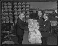 David R. Faries and D. V. Nicholson present petitions to County Registrar of Voters William M. Kerr, Los Angeles, 1935