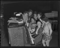 Pianist with Elmer Maiden and chorus girls during a rehearsal for a vaudeville show sponsored by the W.P.A., Los Angeles, 1935