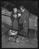 "Frank Kurtz, aviator, and Betty Driscoll, USC student, next to his plane ""Yankee Boy,"" Los Angeles, 1935"