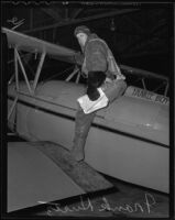 "Frank Kurtz, aviator, seated on his plane ""Yankee Boy,"" Los Angeles, 1935"