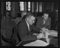 Robert F. Witter and Lewis E. Arnold, city employees at work in the council chamber, Los Angeles, 1935