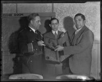 Mexican Consul Ricardo Hill attends as General Saturnino Cedillo presents dueling pistols to Sherriff James E. Davis, Los Angeles, 1935