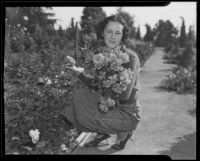 "Marjorie McNeal holding an armful of ""Carrie Jacobs Bond"" roses at a fall rose show, Montebello, 1935"