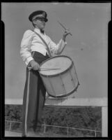 Ralph Morris of the Baldwin Park Boosters Band playing a tenor drum, 1935