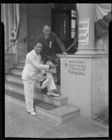 Lorenzo C. Close, with Milton R. Standish, points to his handprint on the Elks Lodge, Santa Monica, 1935